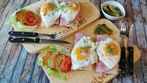 Image of protein - eggs, ham, cheese and salad on food tray